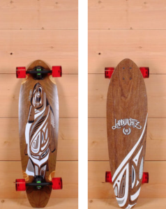 """LANDYACHTZ 36"""" FIBERGLASS STOUT LONGBOARD The Landyachtz 36"""" Fiberglass Stout is designed for carving and cruising. Pressed from 5 plies of vertically laminated bamboo with a fiberglass core and walnut base sheet, it measures 36"""" long and 10"""" wide. The directional platform has wheel wells to prevent wheel bite and a mild W concave for foot support. $250"""