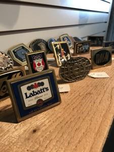 Wide assortment of vintage belt buckles.