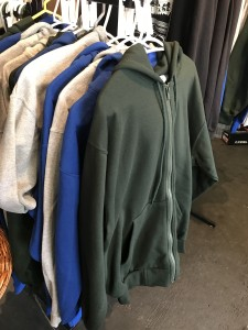 Zip hoodies with hang ten logo on back. Front pouch. Available in forest green, royal blue, athletic gray. $70